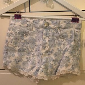 White jean shorts with blue floral and lace trim